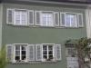 Bestandsfensterläden aus Holz von Reheuser aufbereitet